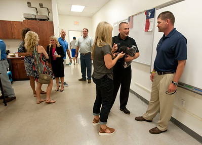 New Robert E. Lee High School head baseball coach James Boxley, right, meets with booster club president David Bates and his wife Melinda Bates Tuesday afternoon at the school's field house. Boxley has 21 years of coaching experience and has worked at Stephenville ISD since 2010.  (photo by Sarah A. Miller/Tyler Morning Telegraph)