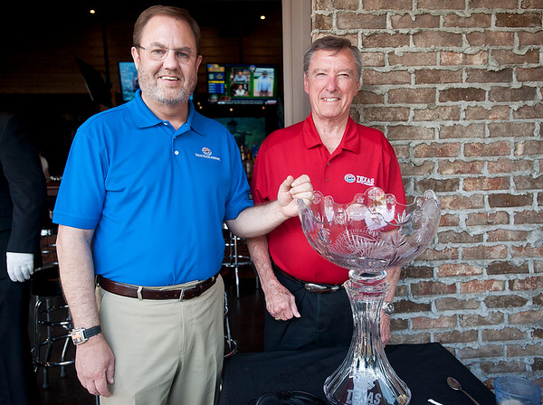 Eddie Gossage, president of Texas Motor Speedway and Johnny Rutherford, three-time Indy 500 winner are pictured at Icehouse Republic Friday in Tyler with the A.J. Foyt-Johnny Rutherford Trophy. The two came to speak in the Bill Coates Radio show to promote the Indy race on June 6 at TMS in Fort Worth.   (photo by Sarah A. Miller/Tyler Morning Telegraph)