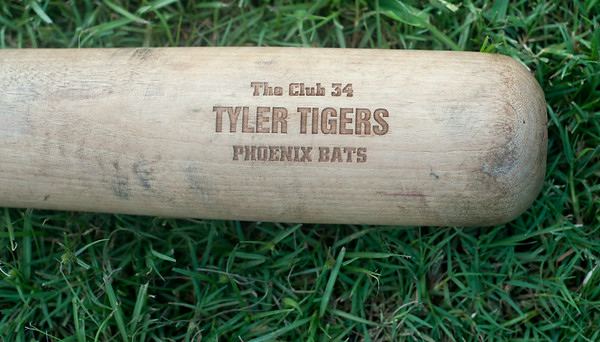 photo by Sarah A. Miller/Tyler Morning Telegraph  A specialized bat made for the Tyler Tigers beep baseball team lies in the grass as practice comes in an end Tuesday July 15, 2014. The Tigers are headed to the National Beep Baseball Association Beep Baseball World Series Aug. 2 in Rochester, Minnesota where they will play three games a day for three days. Beep baseball is an adaptive version of American baseball for blind, visually impaired and legally blind people. Each team also includes a sighted pitcher and catcher. Blindfolded players know where to go by listening for the beeping ball and buzzing bases.