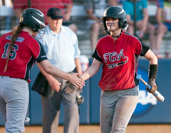 Carthage's Kacey Maines high fives Troup's Josee Ross as Ross comes in from home plate during the Fellowship of Christian Athletes All-Star softball game Friday night at the University of Texas at Tyler's Suddenlink Field.  (photo by Sarah A. Miller/Tyler Morning Telegraph)