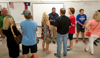 Team players, parents and booster club members wait to meet new Robert E. Lee High School head baseball coach James Boxley Tuesday afternoon at the school's field house. Boxley has 21 years of coaching experience and has worked at Stephenville ISD since 2010.  (photo by Sarah A. Miller/Tyler Morning Telegraph)