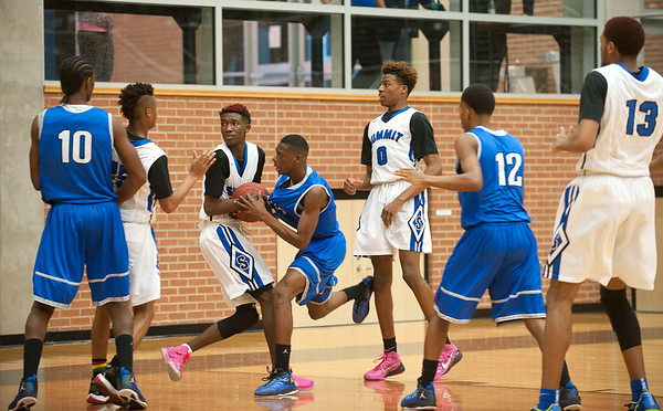 photo by Sarah A. Miller/Tyler Morning Telegraph  John Tyler High School's (24) Ja'Khari Lewis is fouled by Mansfield Summit's (3) Lovell Cabbil during their area playoff game held Saturday at Forney High School. Summit beat the Lions 77-60.