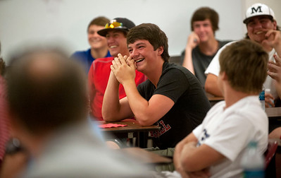 Robert E. Lee High School senior baseball player Jonathan McGown laughs after another player asks the new head baseball coach James Boxley a question about appropriate hair length Tuesday afternoon at the school's field house. Boxley has 21 years of coaching experience and has worked at Stephenville ISD since 2010.  (photo by Sarah A. Miller/Tyler Morning Telegraph)
