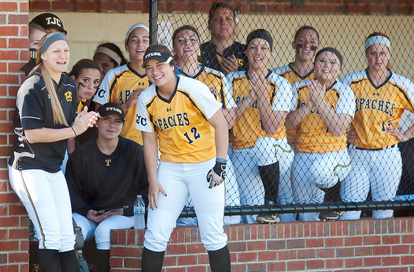 photo by Sarah A. Miller/Tyler Morning Telegraph  Tyler Junior College freshman Brittani Whitten (12), center,  smiles as she cheers loudly with her softball teammates from the dug out during their game against Hill College at Schwab Softball Complex in Bullard.