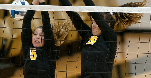 photo by Sarah A. Miller/Tyler Morning Telegraph  Tyler Junior College's (5) Emily Shelton and (19) Aleksandra Gligoric jump but miss the block during their game Friday at Wagstaff Gymnasium against Colby Community College in the Dana Hatch Invite.
