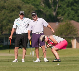 Dan Youngman and Ron England, both of Bullard, watch Deb Youngman as she putts on the 12th green during the Paradise Golf Tournament held Saturday at Emerald Bay Club in Bullard.   (photo by Sarah A. Miller/Tyler Morning Telegraph)