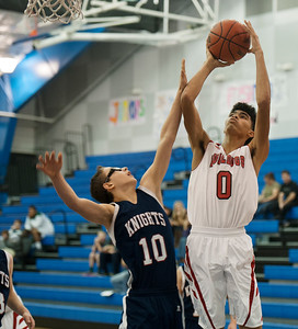 photo by Sarah A. Miller/Tyler Morning Telegraph   Kilgore's X'Aviar Gaona (0) aims for the basket Thursday Dec. 4, 2014 as King's Academy's Karson Sutsch (10) defends in the Bruce G. Brookshire Basketball Classic held at All Saints Episcopal School in Tyler.