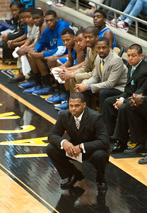 photo by Sarah A. Miller/Tyler Morning Telegraph  John Tyler High School's head basketball coach Cedeno Clark watches during the first half of their area playoff game against Mansfield Summit held Saturday at Forney High School. Summit beat the Lions 77-60.