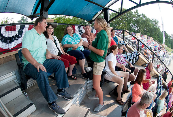 Doug Holcomb, Dee Holcomb, Leslie Andrews and Danny Andrews order concession stand food from their seats at the Pump Jack's first home game Thursday June 4, 2015 at Irwin Field n the campus of The University of Texas at Tyler in Tyler, Texas. They played against the Acadiana Cane Cutters and will face them again Friday night. They play Brazos Valley Bombers Saturday and Sunday at Irwin Field. The Pump Jacks, a Texas Collegiate Wooden Bat League, are playing their first season in Tyler after moving from nearby Kilgore.   (photo by Sarah A. Miller/Tyler Morning Telegraph)