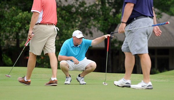 photo by Sarah A. Miller/Tyler Morning Telegraph  Rick Modisette lines up his putt on the seventh green Friday during round one of the 31st Annual Azalea Invitational at Hollytree Country Club.