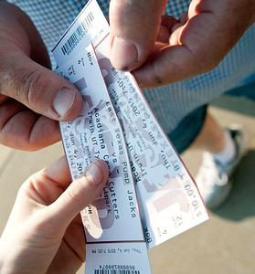 A baseball fan has his ticket checked as he enters the stadium for the East Texas Pump Jacks' first home game Thursday June 4, 2015 at Irwin Field n the campus of The University of Texas at Tyler in Tyler, Texas. They played against the Acadiana Cane Cutters and will face them again Friday night. They play Brazos Valley Bombers Saturday and Sunday at Irwin Field. The Pump Jacks, a Texas Collegiate Wooden Bat League, are playing their first season in Tyler after moving from nearby Kilgore.   (photo by Sarah A. Miller/Tyler Morning Telegraph)