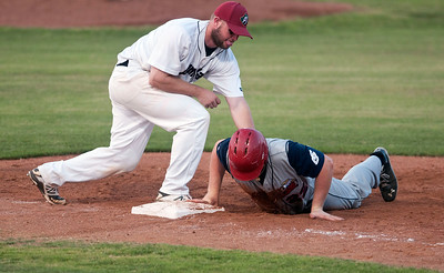 Acadiana's Taylor Braley is safe as Pump Jacks player Alex Bell tags him during the East Texas Pump Jacks' first home game Thursday June 4, 2015 at Irwin Field n the campus of The University of Texas at Tyler in Tyler, Texas. They played against the Acadiana Cane Cutters and will face them again Friday night. They play Brazos Valley Bombers Saturday and Sunday at Irwin Field. The Pump Jacks, a Texas Collegiate Wooden Bat League, are playing their first season in Tyler after moving from nearby Kilgore.   (photo by Sarah A. Miller/Tyler Morning Telegraph)