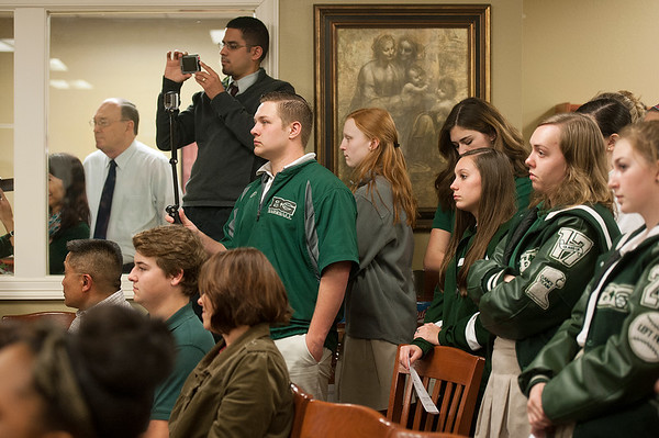 photo by Sarah A. Miller/Tyler Morning Telegraph  Students, staff members and family members watch as Bishop Thomas K. Gorman Regional Catholic School students sign their letters of intent during the NCAA National Signing Ceremony at their school Tuesday.