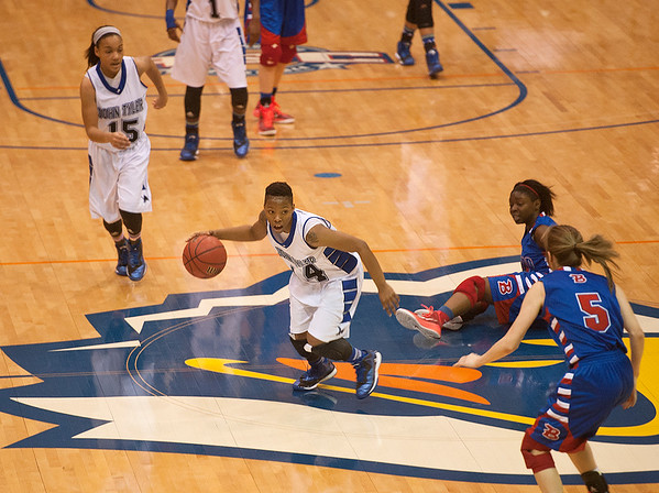 photo by Sarah A. Miller/Tyler Morning Telegraph  John Tyler's Tameal Jones (14) dribbles down the court in their game against Bullard in the Macy Chenevert Patriot Classic held Wednesday Dec. 31, 2014 at the University of Texas at Tyler Patriot Center.