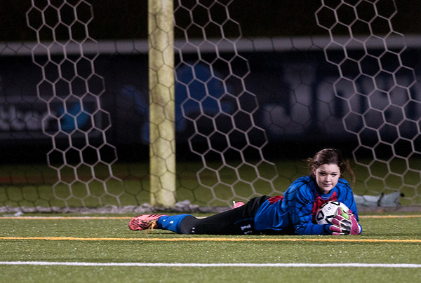 photo by Sarah A. Miller/Tyler Morning Telegraph  Lindale goalie Kamryn York dives to save the ball during their game Friday night against John Tyler at Trinity Mother Frances Rose Stadium.