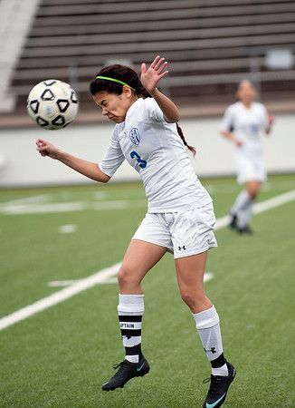 photo by Sarah A. Miller/Tyler Morning Telegraph  John Tyler's (3) Jolenne Calleja heads the ball during their game against Lufkin at Trinity Mother Frances Rose Stadium Friday night.