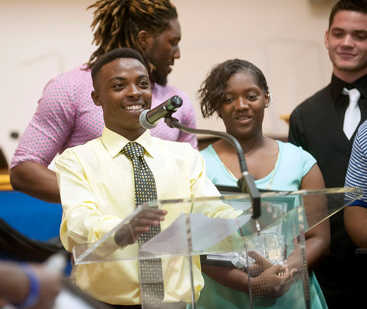 Track and field athlete Cedric Mosley takes the microphone to give an award to his coach Torey Elder during the John Tyler High School sports banquet Thursday night at St. Louis Baptist Church in Tyler.  (photo by Sarah A. Miller/Tyler Morning Telegraph)