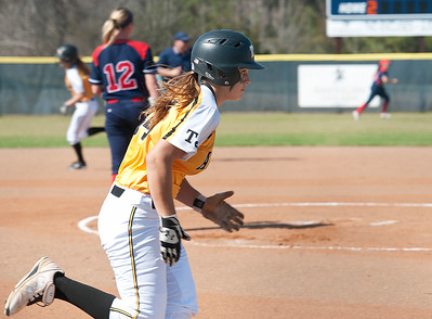 photo by Sarah A. Miller/Tyler Morning Telegraph  Tyler Junior College's (24) Lacie Stevens runs to first base during their game against Hill College at Schwab Softball Complex in Bullard Wednesday Feb. 11, 2015.