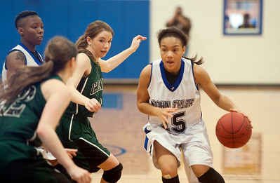 photo by Sarah A. Miller/Tyler Morning Telegraph   John Tyler's Ashtyn Beal (15) looks to get past several Canton defenders during their basketball game on the second day of the Great East Texas Shootout held at the Brownsboro High School gymnasium Friday Dec. 12, 2014.