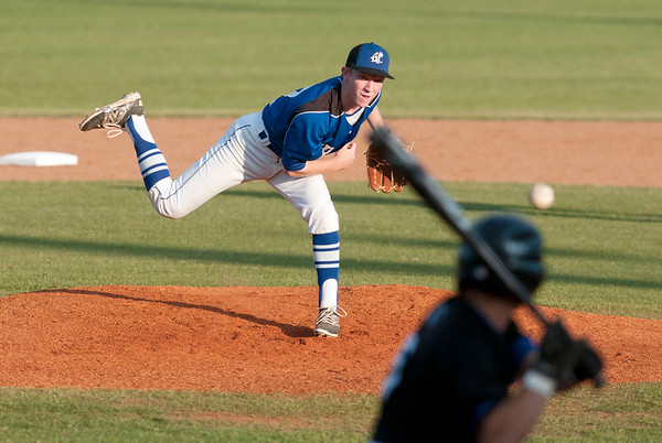 Grace's (12) Blake Holbrook pitches against All Saints Episcopal School's (5) Michael Caruso bats Thursday night during the TAPPS 2-4A district championship baseball game held at Mike Carter Field.  (photo by Sarah A. Miller/Tyler Morning Telegraph)
