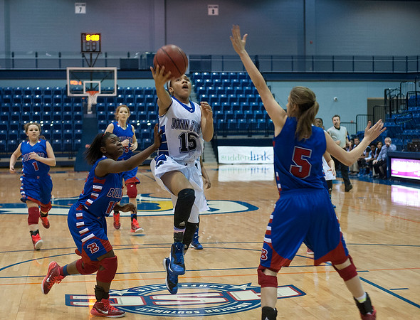 photo by Sarah A. Miller/Tyler Morning Telegraph  John Tyler's Ashtyn Beal (15) sets up for a basket during their game against Bullard in the Macy Chenevert Patriot Classic held Wednesday Dec. 31, 2014 at the University of Texas at Tyler Patriot Center.