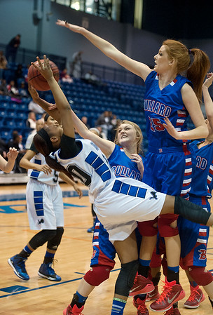 photo by Sarah A. Miller/Tyler Morning Telegraph  John Tyler's Shakendra Tilley (20) is fouled by Bullard's Branay Crayton (21) as she attempts a basket during their game in the Macy Chenevert Patriot Classic held Wednesday Dec. 31, 2014 at the University of Texas at Tyler Patriot Center.