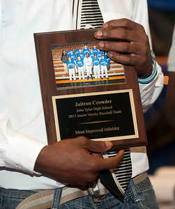 Baseball player Jaitron Crowder holds his most improved infielder award during the John Tyler High School sports banquet Thursday night at St. Louis Baptist Church in Tyler.  (photo by Sarah A. Miller/Tyler Morning Telegraph)