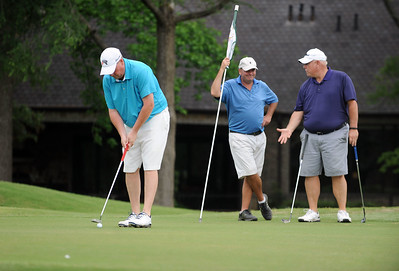photo by Sarah A. Miller/Tyler Morning Telegraph  Rick Modisette putts on the seventh green Friday during round one of the 31st Annual Azalea Invitational at Hollytree Country Club. Also pictured are Brian Maxey, center, and David Bridges, right.