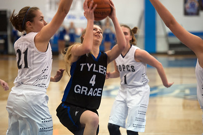 photo by Sarah A. Miller/Tyler Morning Telegraph  Grace Community School's (4) Addie Daughtry goes for a basket during their game against Prince of Peace Christian School Friday during the TAPPS 2-4A District Tournament held at All Saints Episcopal School.