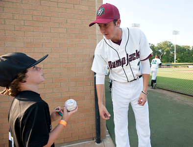 Player Anthony Donovan autographs a baseball for fan Levi Huff, 8, of Van, before East Texas Pump Jacks' first home game Thursday June 4, 2015 at Irwin Field n the campus of The University of Texas at Tyler in Tyler, Texas. They played against the Acadiana Cane Cutters and will face them again Friday night. They play Brazos Valley Bombers Saturday and Sunday at Irwin Field. The Pump Jacks, a Texas Collegiate Wooden Bat League, are playing their first season in Tyler after moving from nearby Kilgore.   (photo by Sarah A. Miller/Tyler Morning Telegraph)