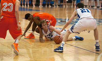 photo by Sarah A. Miller/Tyler Morning Telegraph  All Saint's (12) Matthew Brunson and Brook Hill's Alex Hale fall during their game Friday night Feb. 13, 2015 during the TAPPS 2-4A District Tournament held at All Saints Episcopal School.