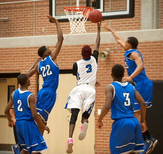 photo by Sarah A. Miller/Tyler Morning Telegraph  John Tyler High School players can't stop Mansfield Summit's (3) Lovell Cabbil from making a basket during their area playoff game held Saturday at Forney High School. Summit beat the Lions 77-60.