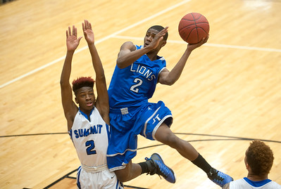 photo by Sarah A. Miller/Tyler Morning Telegraph  John Tyler High School's (2) Bryson Smith goes up for a basket against Mansfield Summit's (2) Kerrion Campbell during their area playoff game held Saturday at Forney High School. Summit beat the Lions 77-60.