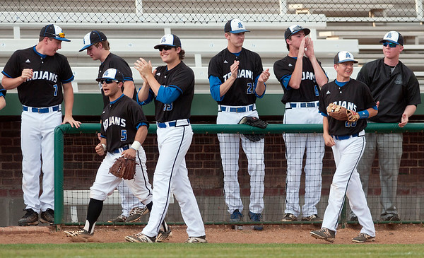All Saints Episcopal School players applaud in the dugout as (13) Charlie Short and (10) Parker Towns cross home plate Thursday night during the TAPPS 2-4A district championship baseball game against Grace Community School held at Mike Carter Field.  (photo by Sarah A. Miller/Tyler Morning Telegraph)
