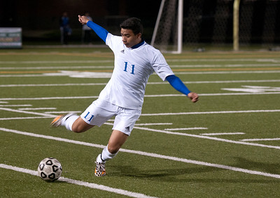 photo by Sarah A. Miller/Tyler Morning Telegraph  John Tyler's (11) Freddy Hernandez kicks the ball during the District 16-5A boys soccer match between John Tyler High School and Nacogdoches Friday night at Trinity Mother Frances Rose Stadium in Tyler.