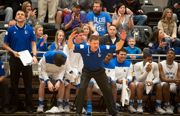 photo by Sarah A. Miller/Tyler Morning Telegraph  Lindale High School head basketball coach Scott Albritton celebrates after the team makes a comeback in the second quarter during their area playoff game against Lancaster held Saturday at Forney High School.