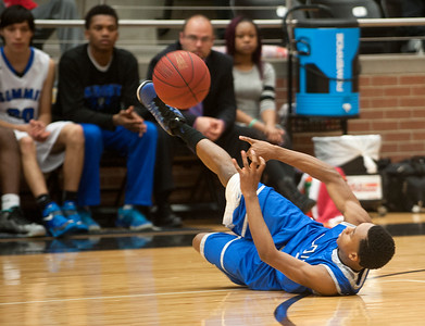 photo by Sarah A. Miller/Tyler Morning Telegraph  John Tyler High School's (1) Martese Christian passes the ball as he falls during their area playoff game against Mansfield Summit held Saturday at Forney High School. Summit beat the Lions 77-60.
