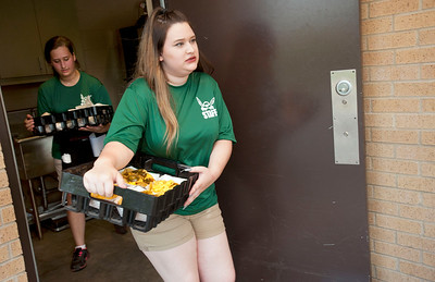 Sisters Kylee White, left, and Jolee White, right, carry trays of food from the concession stand to baseball fans in the stand during the East Texas Pump Jacks' first home game Thursday June 4, 2015 at Irwin Field n the campus of The University of Texas at Tyler in Tyler, Texas. They played against the Acadiana Cane Cutters and will face them again Friday night. They play Brazos Valley Bombers Saturday and Sunday at Irwin Field. The Pump Jacks, a Texas Collegiate Wooden Bat League, are playing their first season in Tyler after moving from nearby Kilgore.   (photo by Sarah A. Miller/Tyler Morning Telegraph)
