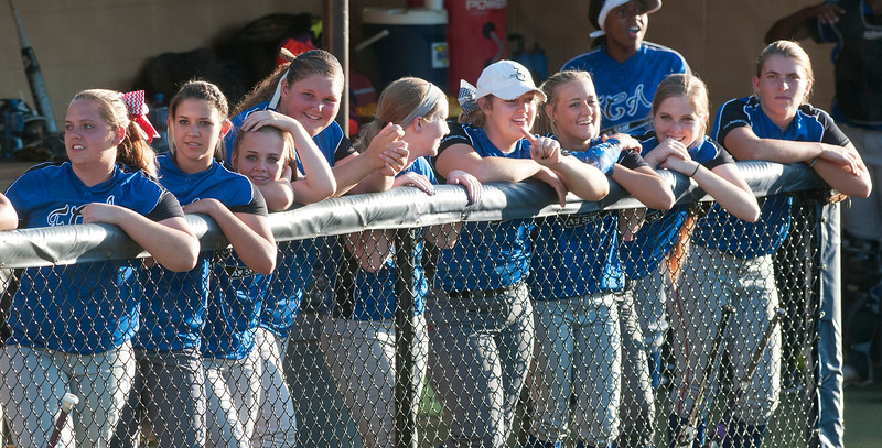 Members of the blue team watch from the dugout during the Fellowship of Christian Athletes All-Star softball game Friday night at the University of Texas at Tyler's Suddenlink Field.  (photo by Sarah A. Miller/Tyler Morning Telegraph)