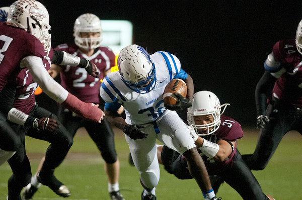 photo by Sarah A. Miller/Tyler Morning Telegraph  Lindale's Ryan Taylor (32) is stopped by Whitehouse's Khyree Key (31)  in the first half of their game in Whitehouse Friday night Nov. 7, 2014.