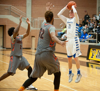 photo by Sarah A. Miller/Tyler Morning Telegraph  Lindale's (2) Laettner Greenhill shoots and makes a basket in the first quarter of their area playoff game against Lancaster held Saturday at Forney High School.