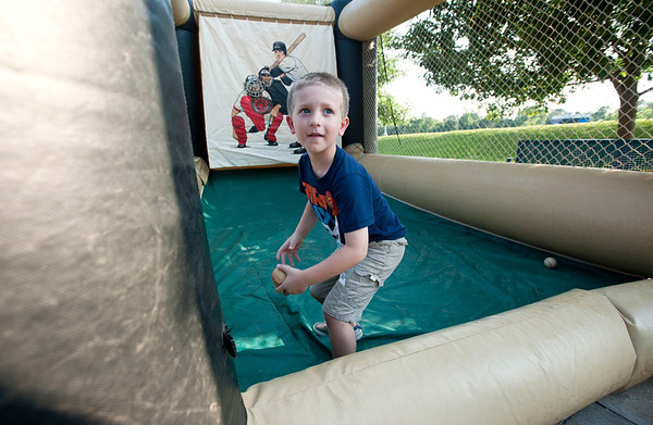 Graham Smith, 6, plays a speed pitch game before the start of the East Texas Pump Jacks' first home game Thursday June 4, 2015 at Irwin Field n the campus of The University of Texas at Tyler in Tyler, Texas. They played against the Acadiana Cane Cutters and will face them again Friday night. They play Brazos Valley Bombers Saturday and Sunday at Irwin Field. The Pump Jacks, a Texas Collegiate Wooden Bat League, are playing their first season in Tyler after moving from nearby Kilgore.   (photo by Sarah A. Miller/Tyler Morning Telegraph)