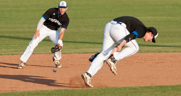 All Saints Episcopal School's (4) Logan Bradford, left, and (10) Parker Towns, right, work to catch the ball Thursday night during the TAPPS 2-4A district championship baseball game against Grace Community School held at Mike Carter Field.  (photo by Sarah A. Miller/Tyler Morning Telegraph)