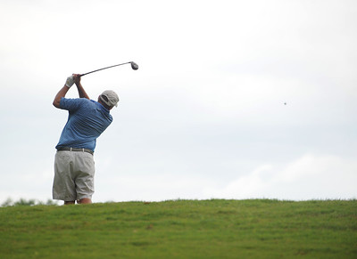 photo by Sarah A. Miller/Tyler Morning Telegraph  Brian Maxey swings on the seventh tee Friday during round one of the 31st Annual Azalea Invitational at Hollytree Country Club.