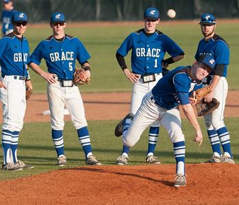 Grace's (12) Blake Holbrook practices his pitch Thursday night during the TAPPS 2-4A district championship baseball game held at Mike Carter Field.  (photo by Sarah A. Miller/Tyler Morning Telegraph)