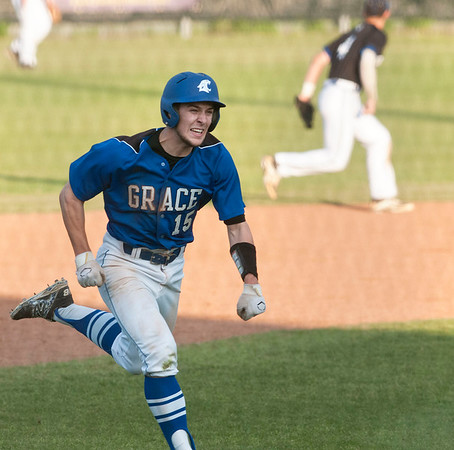 Grace's (15) Chris McLeod smiles as he heads for home plate Thursday night during the TAPPS 2-4A district championship baseball game against All Saints Episcopal School held at Mike Carter Field.  (photo by Sarah A. Miller/Tyler Morning Telegraph)