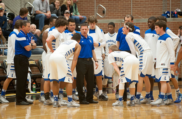 photo by Sarah A. Miller/Tyler Morning Telegraph  Lindale High School basketball coach Scott Albritton talks to his players during a timeout in the first quarter of their area playoff game against Lancaster held Saturday at Forney High School.