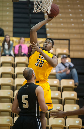 photo by Sarah A. Miller/Tyler Morning Telegraph  Tyler Junior College basketball player John Paul shoots a basket Tuesday Dec. 30, 2014 at Wagstaff Gymnasium during their game against Houston Community College Northwest.
