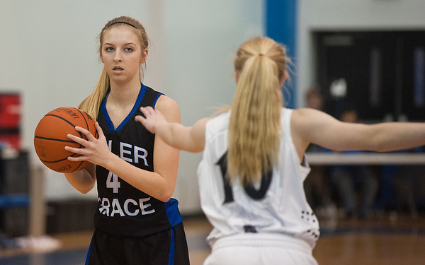 photo by Sarah A. Miller/Tyler Morning Telegraph  Grace Community School's ((4) Addie Daughtry looks past Prince of Peace Christian School's (10) Chloe Bibler to make a pass Friday during the TAPPS 2-4A District Tournament held at All Saints Episcopal School.