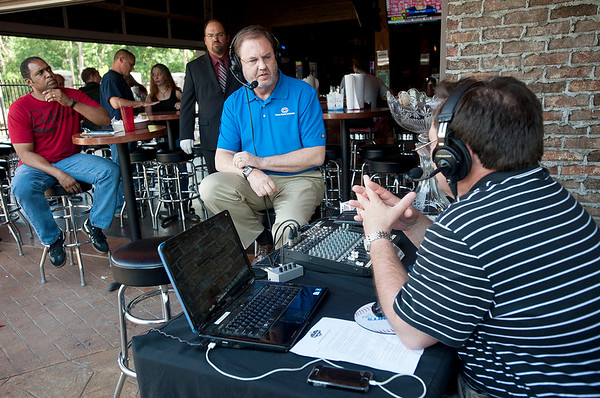 Eddie Gossage, president of Texas Motor Speedway speaks with Bill Coates at Icehouse Republic Friday in Tyler with the A.J. Foyt-Johnny Rutherford Trophy. Gossage and Johnny Rutherford, three-time Indy 500 winner, came to speak in the Bill Coates Radio show to promote the Indy race on June 6 at TMS in Fort Worth.   (photo by Sarah A. Miller/Tyler Morning Telegraph)